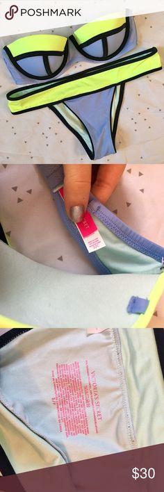 VS Colorblock Bikini Worn once, great condition! Bandeau Top is 32C, Bottoms are small Victoria's Secret Swim Bikinis
