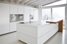 #white #kitchen #design #minimal #kitchenisland #minimalism #interiors White kitchen island. The downdraft hood enhances the design essentiality and the sculptural faucet characterizes the design of the kitchen | Todeschini Cucine
