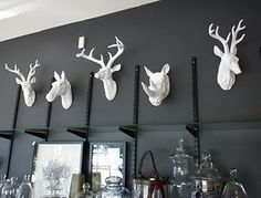 White animal heads for the black dining room
