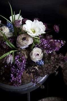 Lovely, rich design with ranunculus, fritillaries and blue muscari