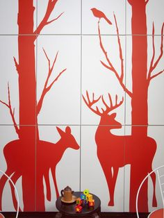 Kitchen Cabinets as Concealed Storage  Adding a focal point was a main design element for Evander and Frankie's bedroom. By installing ready-made kitchen cabinets to the wall, then adding graphic interest with vinyl decals in the shape of a fawn…