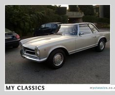 1968 Mercedes-Benz 280 SL Pagoda classic car. MY DAD HAS A CAR JUST LIKE THIS.