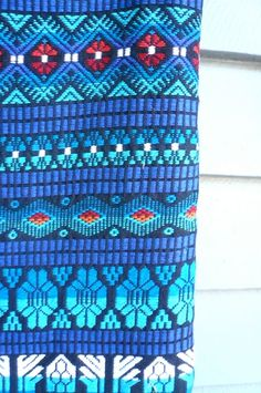 Gorgeous bright colors in the woven cotton Mexican textile. Pretty turquoise…