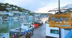 Trawlers on the Quay in Looe - eat beautiful fresh fish on the bustling quay at this award-winning restaurant (Taste of the West 2013 Gold).