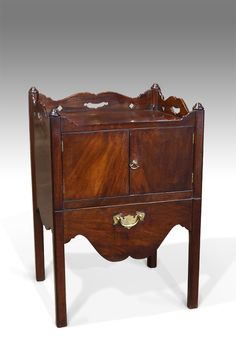 Shaped gallery top with pierced hand holds, over figured doors fitted with brass axe head handle. Raised on square moulded legs. Antique Bedside Tables, Antique Bedroom Furniture, Georgian Furniture, Pots, Antique Wardrobe, Axe Head, Bedside Cabinet, Cupboard, Tray