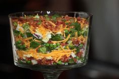 Seven layer salad.beautiful centerpiece salad for parties, showers, bunco night and holidays! Try this perfect, traditional Seven layer Salad with one slight twist to make it even better. Seven Layer Salad Dressing recipe is included! Seven Layer Salad Dressing Recipe, Salad Dressing Recipes, Salad Recipes, Salad Dressings, Great Recipes, Dinner Recipes, Favorite Recipes, Dinner Ideas, Yummy Recipes
