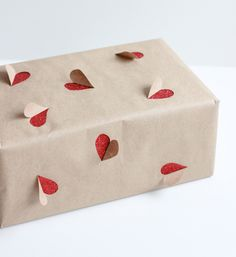 First impressions are everything; which is precisely why this Valentine's Day you should be treating your gift wrapping as importantly as the actual gift giving. Whether you're purchasing a gorgeous wrapping paper or getting crafty by making some yourself, you're sure to impress your loved one with these totally Pin-worthy, Instagrammable last-minute gift wrapping ideas.