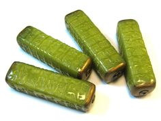 Faux Jade Asian Kanji Tower Beads | Flickr - Photo Sharing! Faux Jade Asian Kanji Tower Beads  Made with Pardo and baked at 325 degrees F for 30 minutes then sanded and buffed. I usually use Premo and bake at 275 degrees F for 30 minutes. This is a much brighter green than I usually get with Premo.