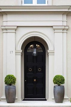 Large molding frames out this curved black front door
