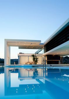 Fabulous exterior - modern house build suspended over swimming pool!
