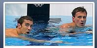 401b: This photo shows two members of the American men's swimming team. Both of the swimmers take up an equal amount of space in the photo, perhaps to emphasize that they are a team, and a strong one at that. The story corresponding to this photo was not the main focus of the web page. We know that these swimmers are American because of their fame and do not need a flag to identify them.
