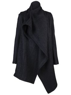 Oversized long sleeve coat in black from Julius. This wool-blend mid-length coat features a large shawl collar with back draping, hidden pockets on the waist and black lining.