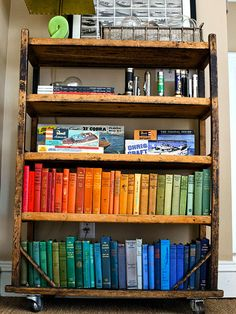Organize thrift store books by color for a one-of-a-kind display. See more flea market chic home accents: http://www.bhg.com/decorating/decorating-style/flea-market/flea-market-chic-home-accents/?socsrc=bhgpin040313colorfulbooks=4