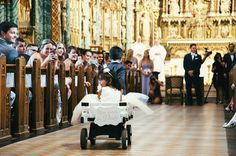Here comes the bride! We designed the cutest little white wagon for this adorable flower girl 🌸  #aw #herecomesthebride #flowergirl #ringbearer #churchwedding #cathedral #gorgeous #whitewagon #weddingideas #luxury #iluphwedding #elegant #weddinginspo #instacute