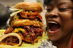 """Hawkins House of Burgers in Los Angeles. Rated """"Best Bargain-Basement Burger"""" by the LA Times. """" Hawkins Special, a truly absurd and behemoth creation consisting of three one-pound burger patties, cheese, bacon, chilies, onions, tomatoes, lettuce, fried eggs, pastrami, mustard, a butterflied hot dog, pickles and mayo. It weighs in at five pounds, costs sixteen bucks, and comes with fries and a soda."""