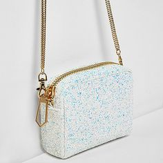Reflective glitter detail Square shape bag  Zip top fastening Detachable snake chain shoulder strap Height 12cm, width 14cm, strap length 123cm
