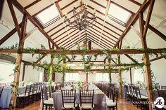 Inn at Barley Sheaf:  Reception space warmed up by trailing vines. Add some swags and lanterns and it could wow the space.