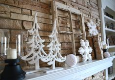 12 Enchanting DIY Christmas Decor Ideas: This winter mantel is the perfect example of elegance, using simple and clean elements.