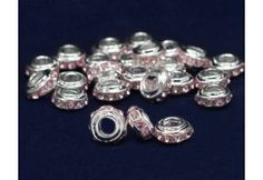 Round Pink Crystal Charm. These beautiful new round pink crystal charms are handmade for our Ribbon Chunky Charm bracelets. The sterling silver plated charm is a circular shape with 10 pink crystals around the outside. Charm is 10 mm x 5 mm with a 5 mm diameter opening. Mix and match to create your own custom bracelets for fundraising or gifts. (CHARM49-1B)