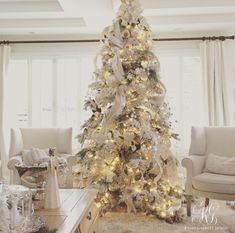 White flocked Christmas tree with mercury glass ornaments and ribbon