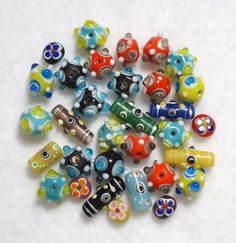 '40 Art Glass Beads in Various Colors and Shapes' is going up for auction at 12pm Tue, Oct 23 with a starting bid of $5.