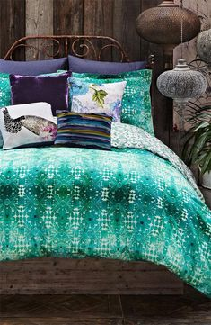 Want! Bright teal and deep purple bedding.