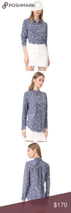 EQUIPMENT Slim Signature Stars Blouse in Grey Clusters of stars float over a contrast background on a cool silk blouse from Equipment. Tonal buttons fasten the placket, and flap pockets detail the front. Fabric: Washed silk. 100% silk. Dry clean. Excellent condition! Equipment Tops Blouses