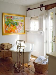 We love the barn-style door in this country bathroom #bathroom #design #inspiration