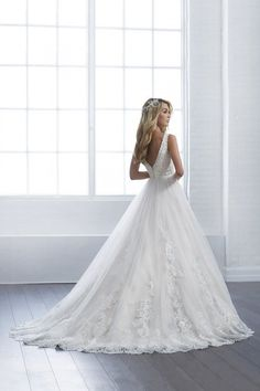 Romantic wedding dress idea - A-line style wedding dress with lace details and v-back. Style 15653 by Christina Wu Brides See more inspiration on WeddingWire!