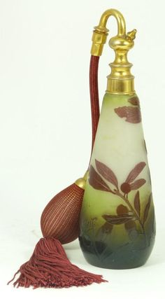 Galle art glass Cameo perfume bottle with atomizer.  Maroon leaves and fruit design over frosted white ground. Galle marks to side. Late 19th to early 20th century.