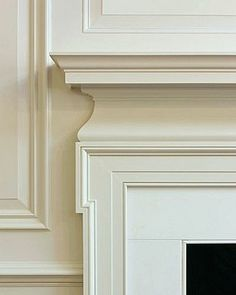 20 Great Fireplace Mantel Decorating Ideas | laurel home blog | fabulous millwork and fireplace mantel by architect Gil Schafer. Love his work! Beautiful tone on tone white paint with coordinating stone. So fresh!