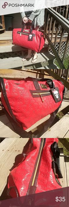 Betsey Johnson skull travel bag This baby is big, bold, and a little bit bad ass. Purchased for a 4day business convention in St.Louis three years ago, and only used on that one venture. Very light wear marks on top (see third photo). Betsey Johnson Bags Travel Bags