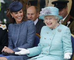 The Duchess of Cambridge laughs as Queen Elizabeth II gestures while they watch part of a children's sports event during a visit to Vernon Park in Nottingham