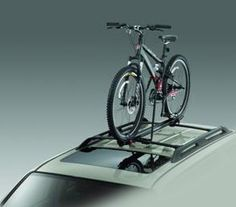 Car Roof Bike Rack / Roof Mounted Bicycle Carrier by Conquer. $19.95. The Upright Bike Mount lets you load your bike onto your roof rack without needing to remove its front wheel. This universal mount carries bikes with wheel sizes 20 to 29 inches and with nearly any tire. The locking clamp secure the bike and requires a key (included) to unlock.