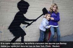Children interact with Banksy's stencils