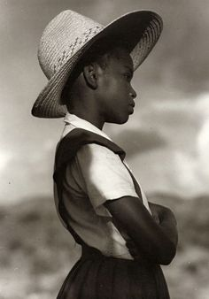Girl with straw hat. 1940.