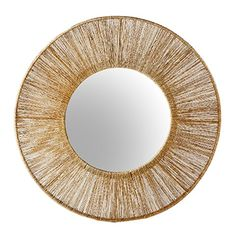 Twisted jute fibers are pulled over a light steel frame to create a statement mirror.