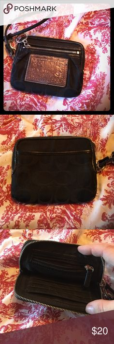 Black COACH poppy wristlet/wallet Black COACH poppy wristlet/wallet, excellent used condition, slight wear at leather strap but lots of life left, numerous pockets for card/cash storage! Coach Bags Wallets