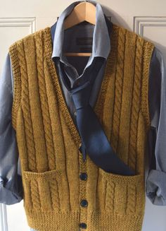 Men's classic knitted vest with simple cable stitch and pockets deep enough for a manly hand.