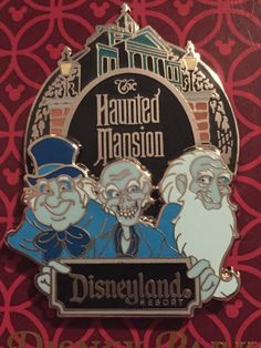 This open edition pin features the Hitchhiking Ghosts in front of The Haunted Mansion® Attraction at Disneyland® Park. Phineas and Gus are next to Ezra who is holding a plaque that sign has the Disney