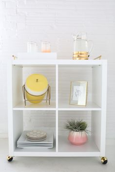 1 kallax book shelf 2 skinny brass pulls 4 brass casters 1 gold foiling pen to color in the silver screws