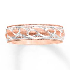 A unique design gives distinctive style to this rose gold wedding band for him.