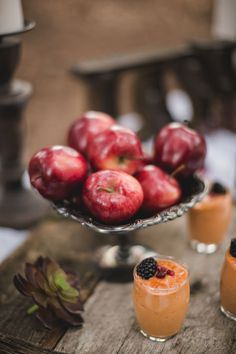 16 Fresh Ideas for a Farm-to-Table Wedding | Who needs fancy décor when you can just use gorgeous fruit instead? The deep red color of apples add some ultra-romantic vibes to a rustic wedding.