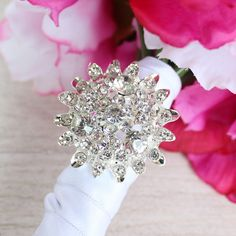 Add a flashy, glamorous touch to your DIY wedding bouquets or floral crafts with this round rhinestone brooch in silver. This sparkly silver jewel brooch is perfect to accent hair accessories, ribbon, napkin ring holders, and so much more! #afloral