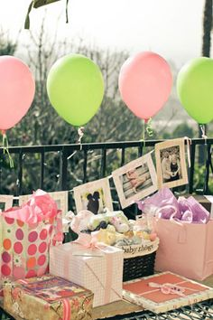 fun girly pink and green baby shower pink and green balloons decorate the gift table