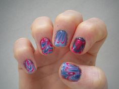 Water Marble nails ver. 2.0  I wanted to try water marbling again. This time I only used two colors; a red shimmer and a dark blue.
