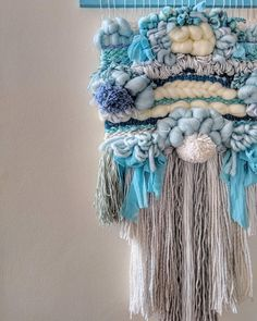 This multilayered blue beauty was inspired by the blue calmness after the craziness of the holidays. Features white and baby blue roving, soft white and grey yarns, and a variety of wool textures. This Peice also has a multilayered and multilength fringe that really centers the piece.