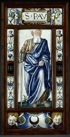 Ces deux plaques proviendraient du couvent des Feuillantines à Paris. Elles sont la répétition des plaques des apôtres du musée des Beaux-Arts de Chartres, signées et datées de 1547, avec, comme différences, la présence de portraits pour les têtes, et le chiffre d'Henri II (1547 - 1559) sur les plaques d'encadrement. Attribué à Léonard LIMOSIN Plaque : Saint Paul, sous les traits de Galiot de Genouillac Vers 1550 Limoges Émail peint sur cuivre H. : 91,50 cm. ; L. : 43,50 cm.