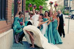 SO MUCH FUN!! I love that you catch a glimpse of her garter & that she's barefoot.. LOVE THE BRIDESMAID DRESSES!!!