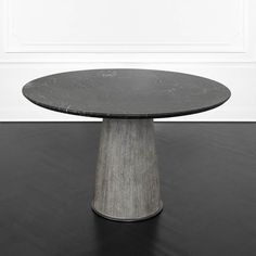 KELLY WEARSTLER | CAMDEN TABLE. Composed of a solid wire brushed cerused Wenge base with a brass foot and collar in burnished bronze patina. The top is a reversed beveled edge of honed and sealed cosmic black marble with a blackened bronze edge